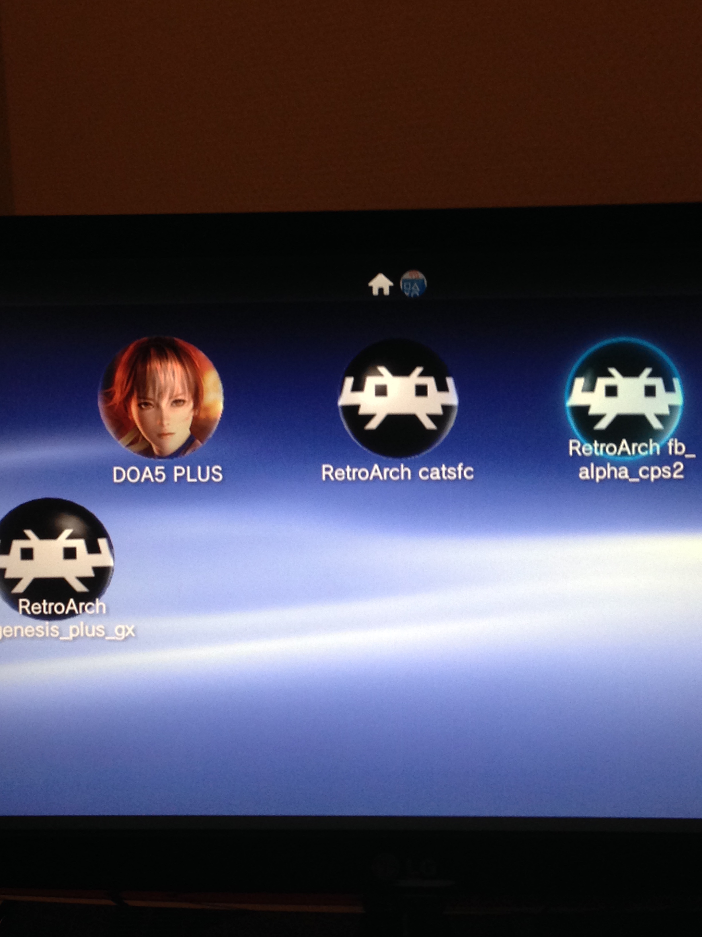 RetroArch appearing on the PS Vita Live Area homepage.  Screenshot was taken on a PS TV.